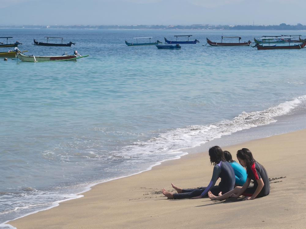 Local girls on the beach in Bali |curlytraveller.com