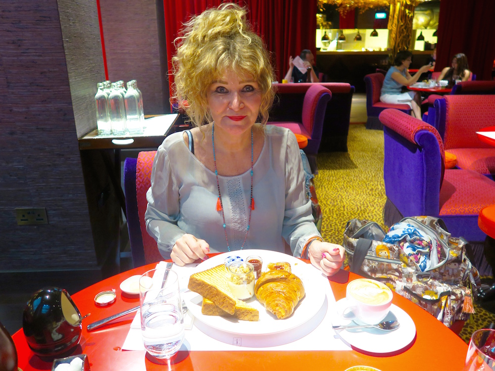 Woman having breakfast at Hotel Vagabond Singapore |curlytraveller.com