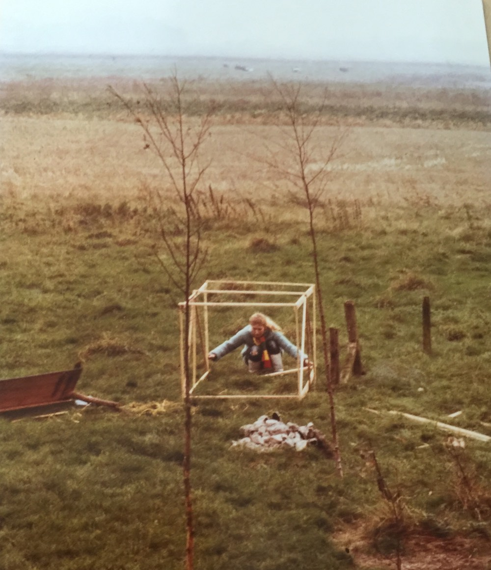 Woman building chicken run in the countryside |curlytraveller.com