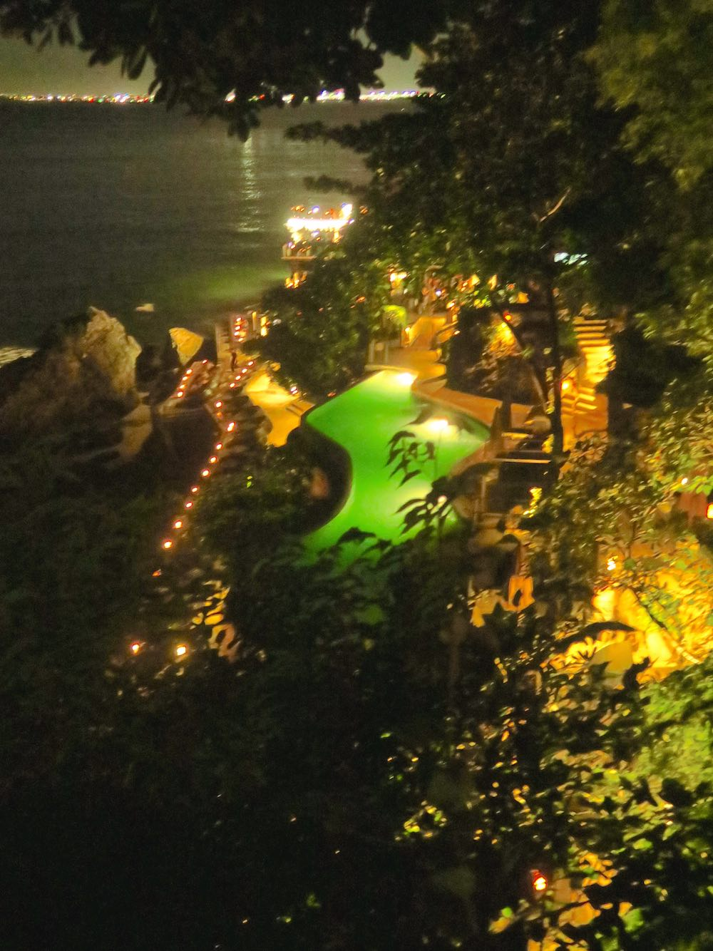 Ayana Resort's infinity pool and Rock Bar by night |curlytraveller.com