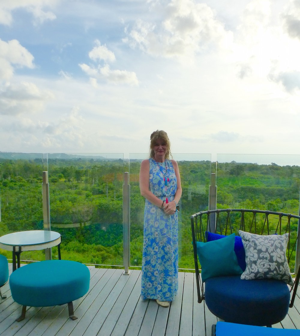 Woman standing at pool area from bar Unique Bali |curlytraveller.com