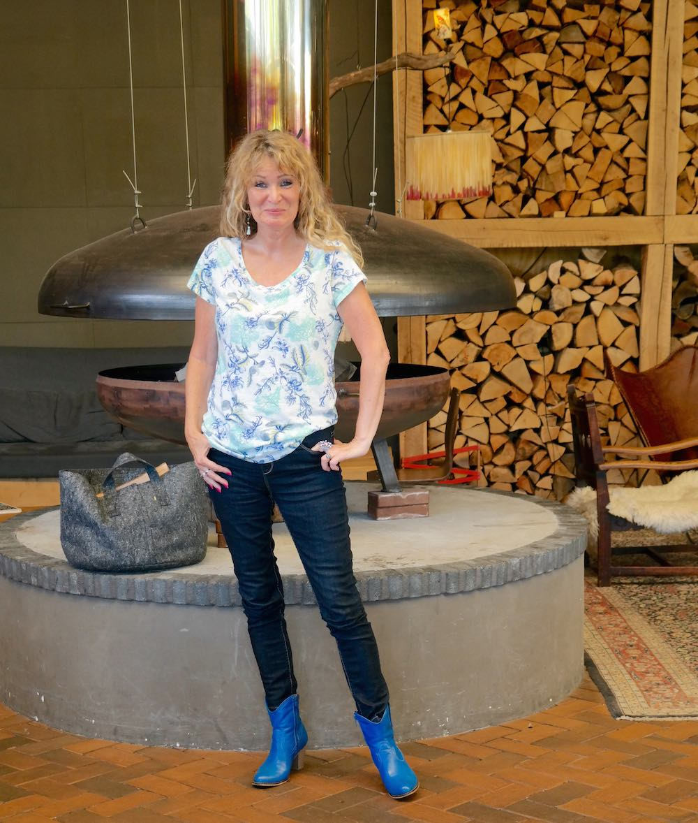 Woman in front of fireplace at Buitenplaats Plantage |curlytraveller.com