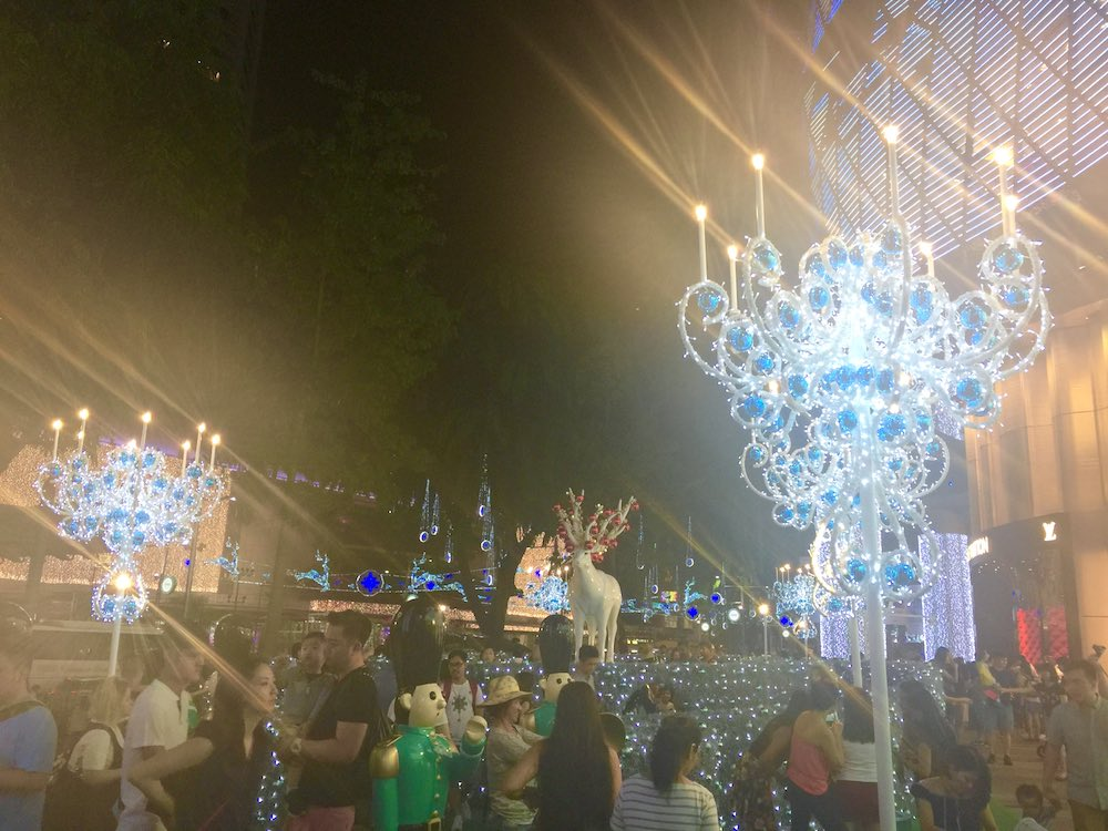 People walking through christmas decor of ION Orchard |curlytraveller.com
