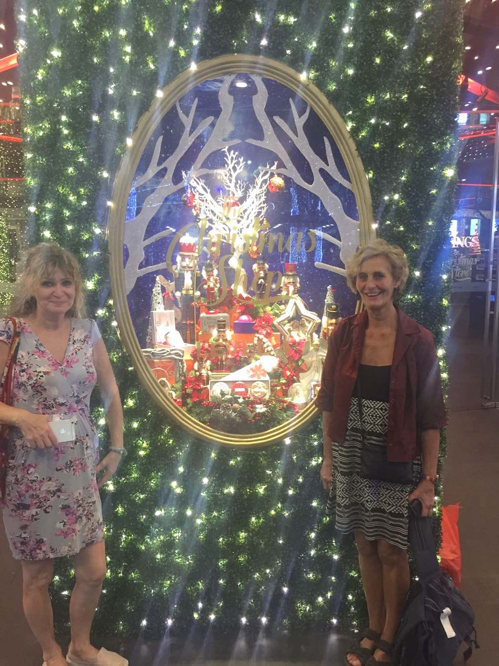 two women in front of Tang's christmas decorations |curlytraveller.com