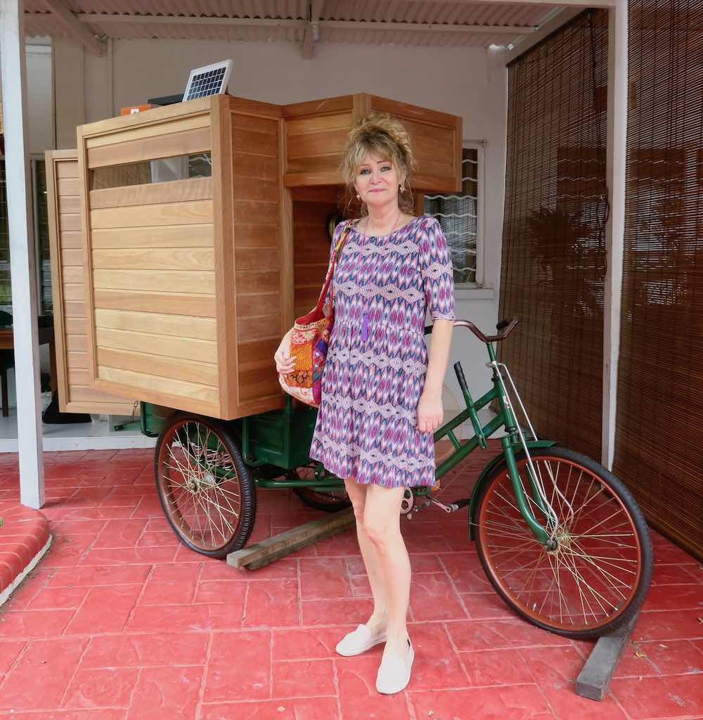 Woman in front of tricycle at the Bizarre Honour |curlytraveller.com