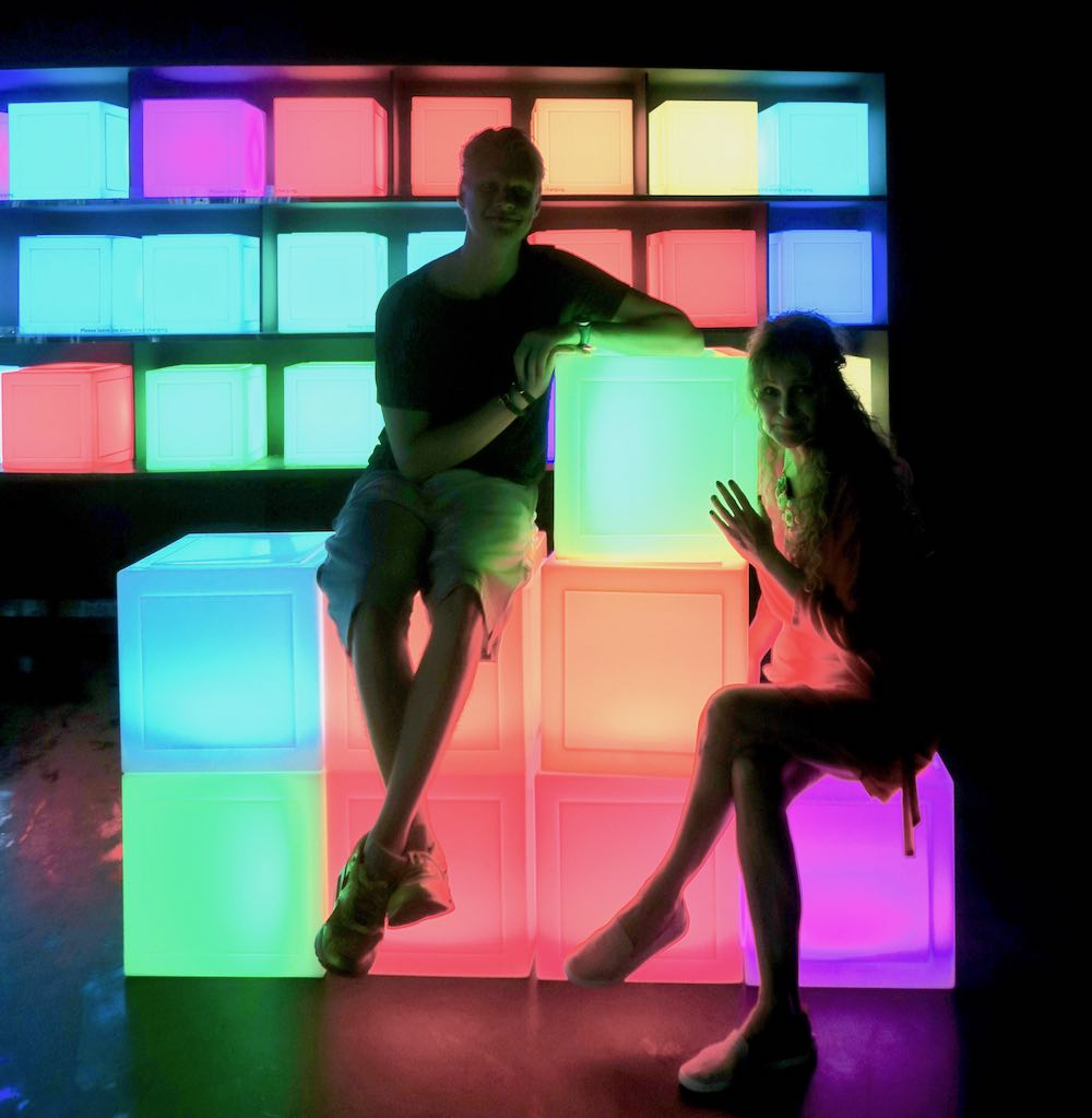 Young man and woman posing on colourful cubes at ArtScienceMuseum |curlytraveller.com