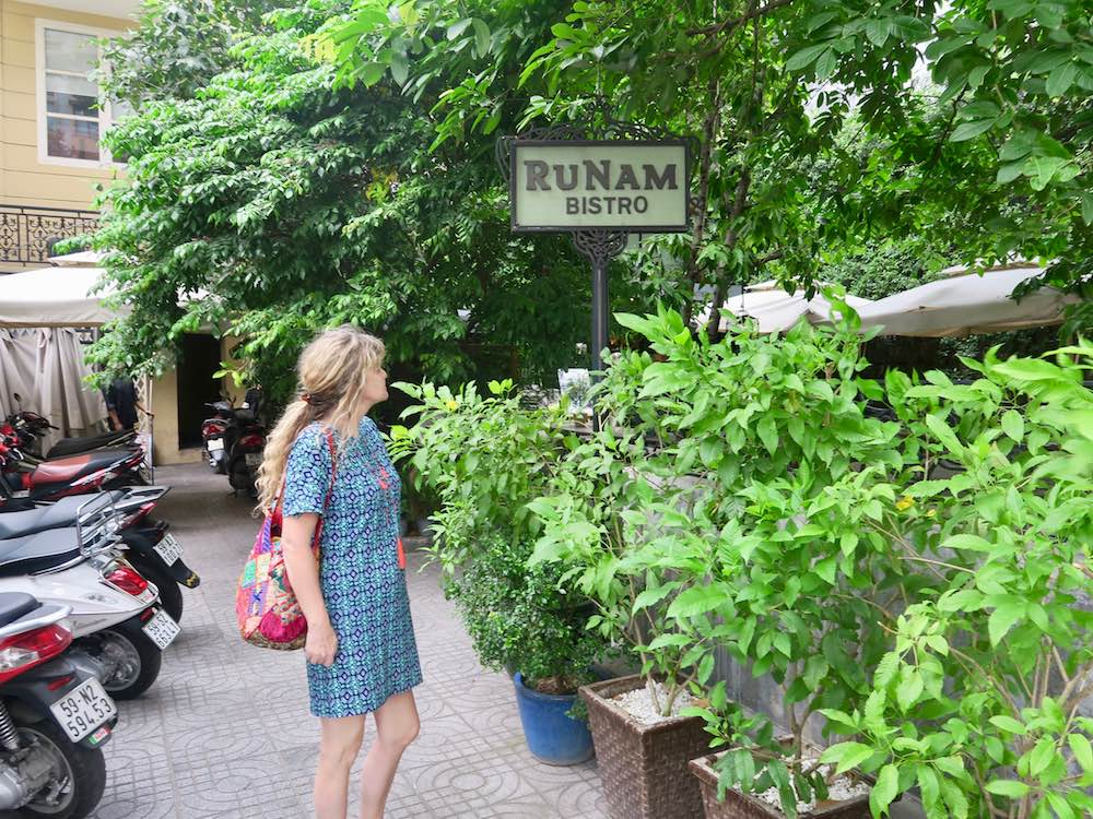 Woman looking at Cafe Runam in Saigon |curlytraveller.com