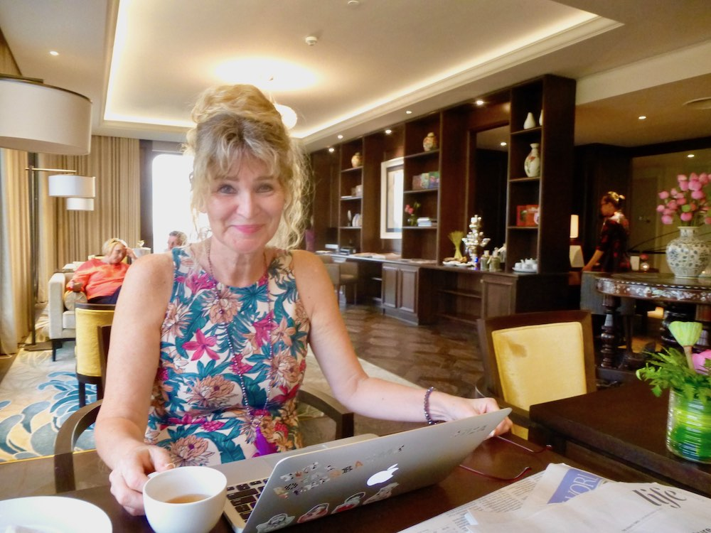 Woman drinking tea at Sky Lounge at Hotel des Arts |curlytraveller.com