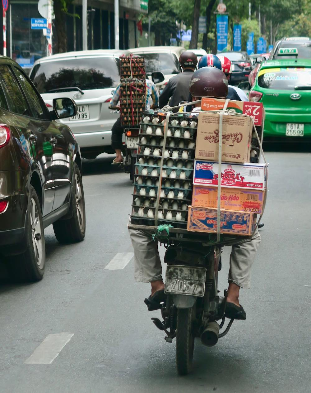 Lots of eggs being transported by motorbike in Vietnam |curlytraveller.com