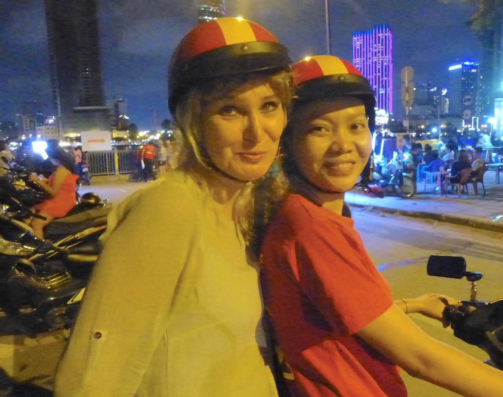 Two women on motorbike in Saigon during Back of the Bike tour |curlytraveller.com