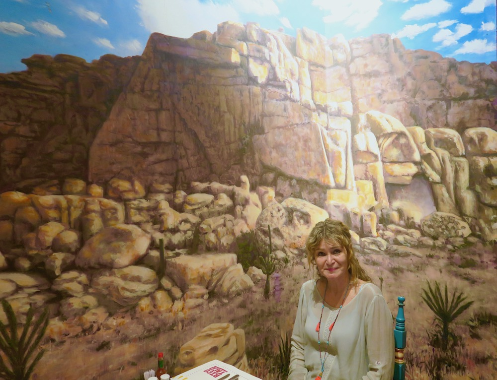 Woman in front of mural in Rico Taco |curlytraveller.com