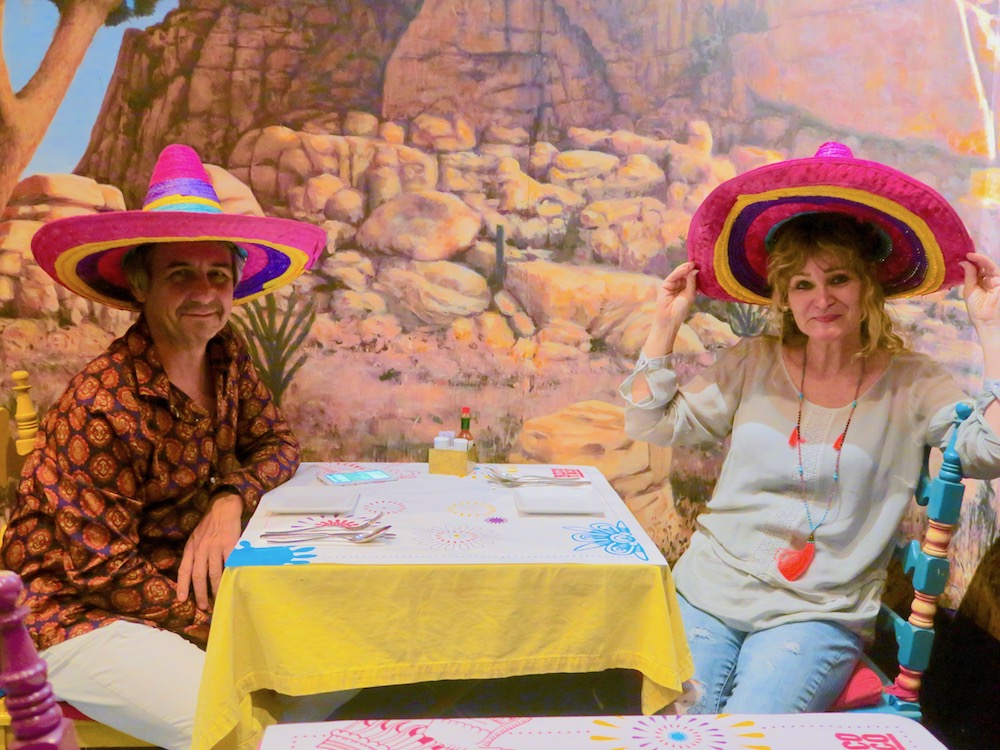 Couple in Mexican restaurant wearing a sombrero |curlytraveller.com