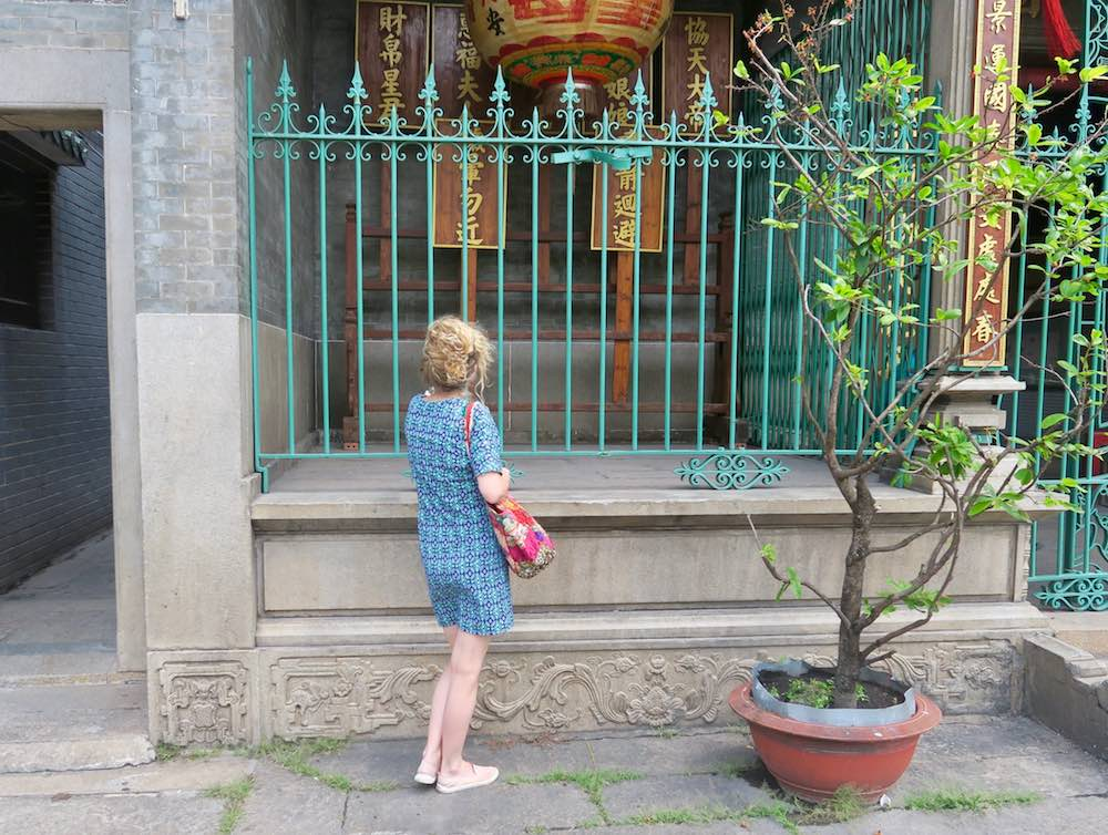 Woman in front of temple in Cholon Saigon |curlytraveller.com