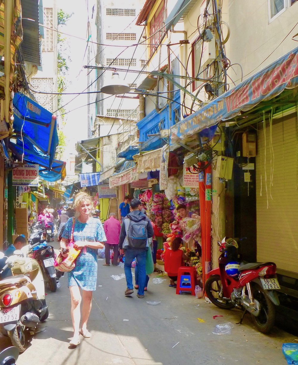 Woman in bead alley in Cholon |curlytraveller.com