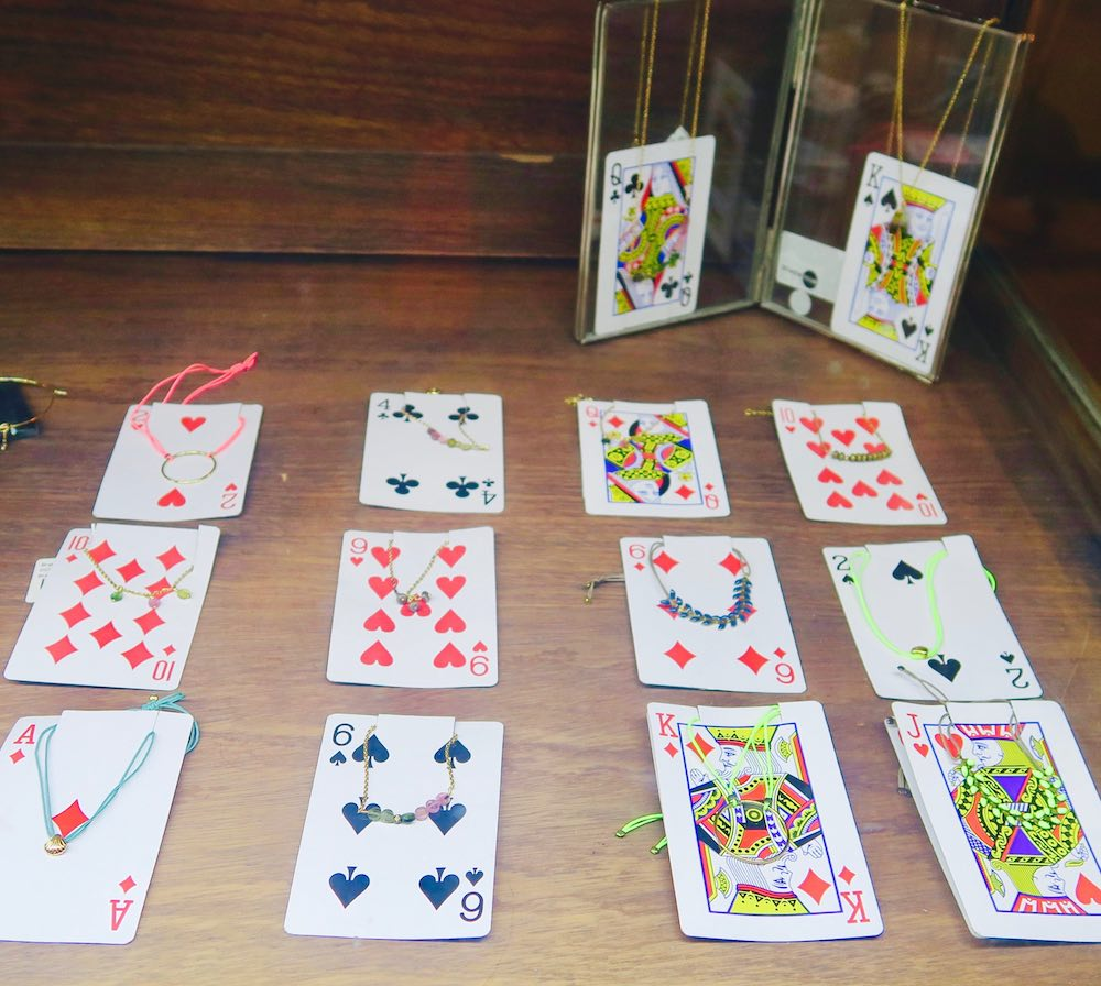 Jewellery displayed on playing cards in L'Usine le Loi |curlytraveller.com