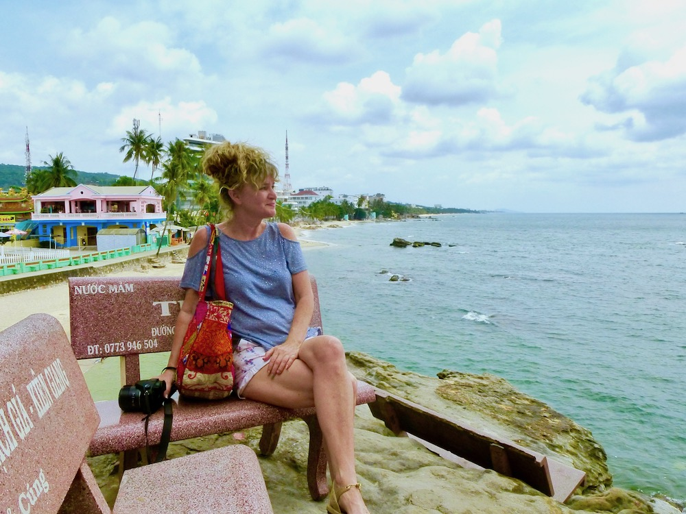 Woman on a bench in Duong Duong, Phu Quoc |curlytraveller.com