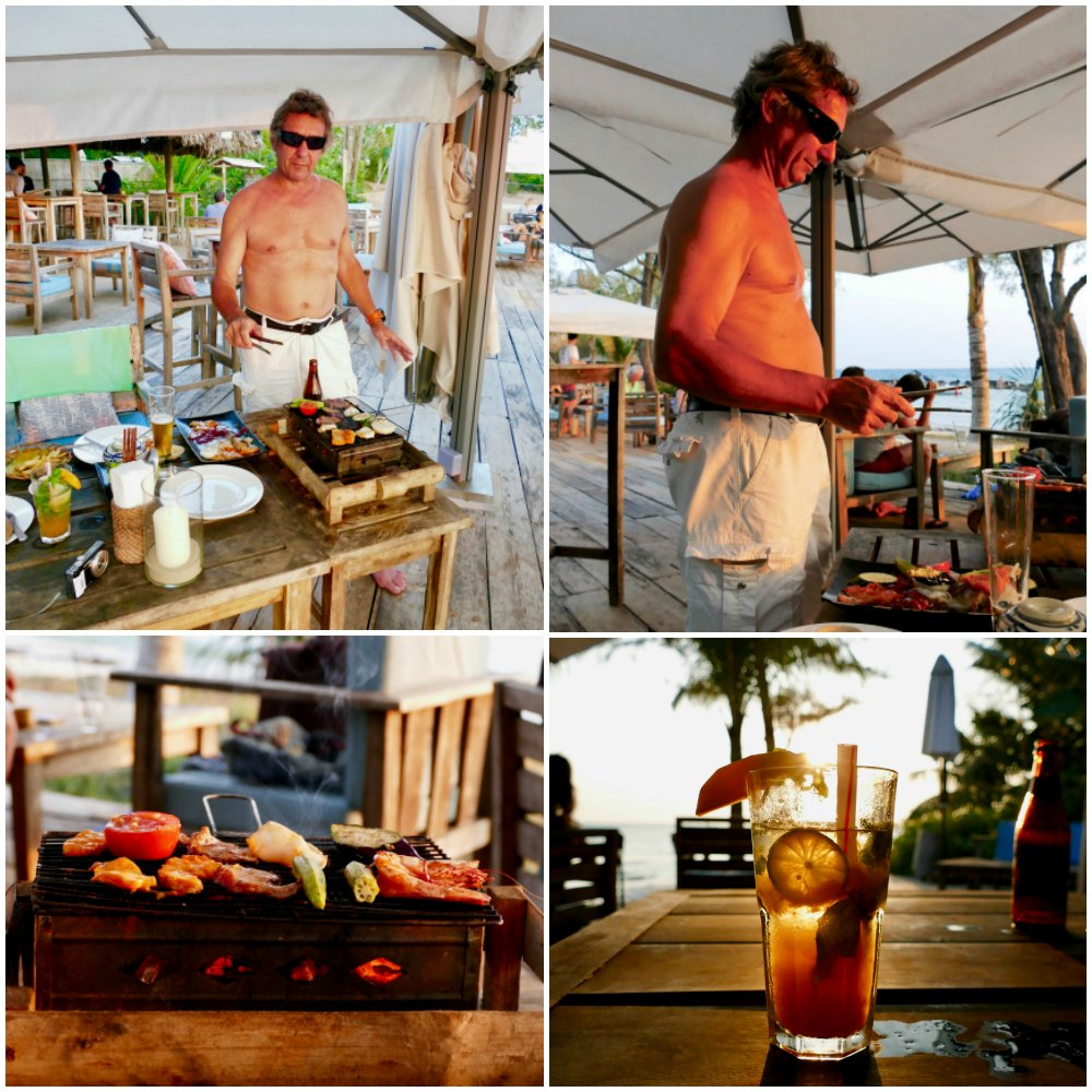 Man BBQ-ing at table in Mango Bay Resort bar |curlytraveller.com
