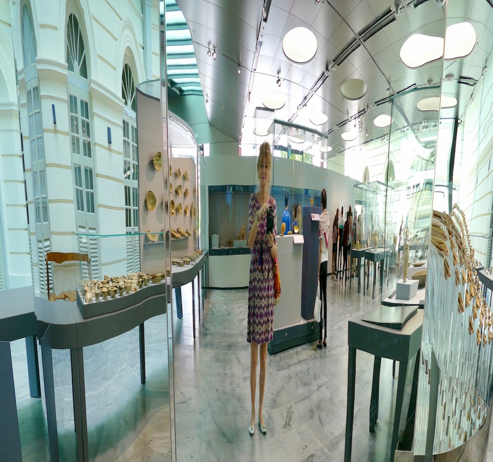 Woman's reflection in skinny mirror at Asian Civilisations Museum Singapore |curlytraveller.com