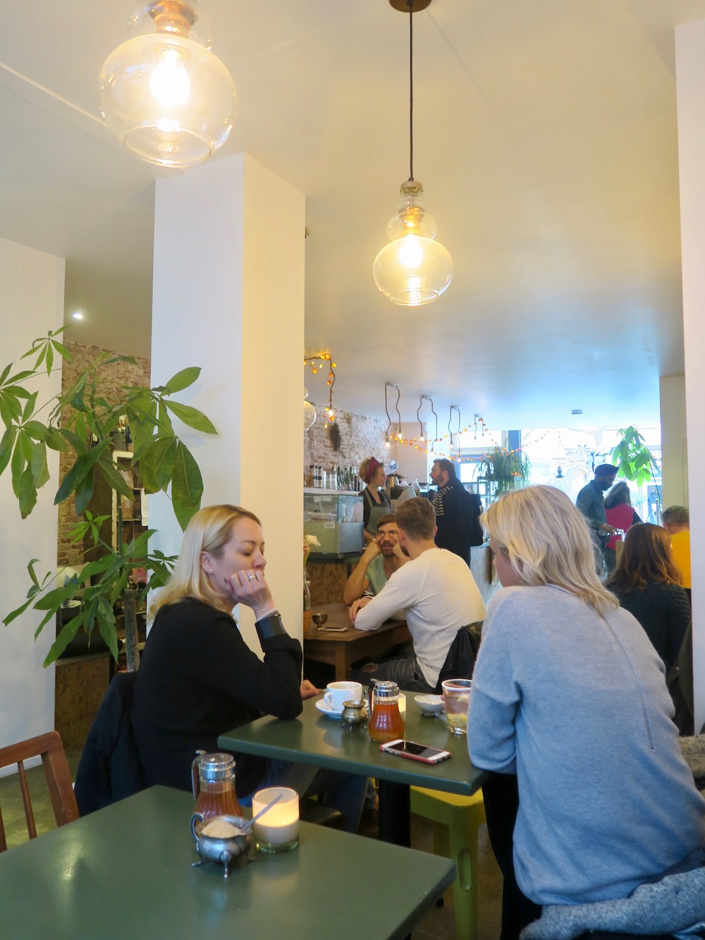 Friends meeting over coffee in Native |curlytraveller.com