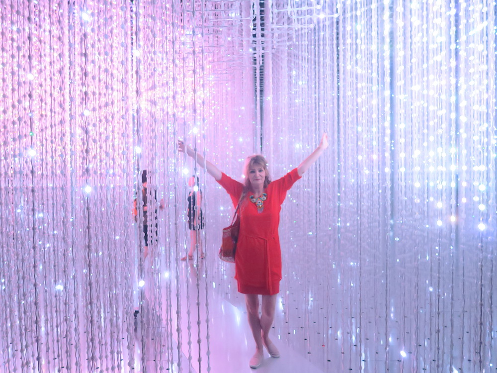 Woman in red in art installation |curlytraveller.com