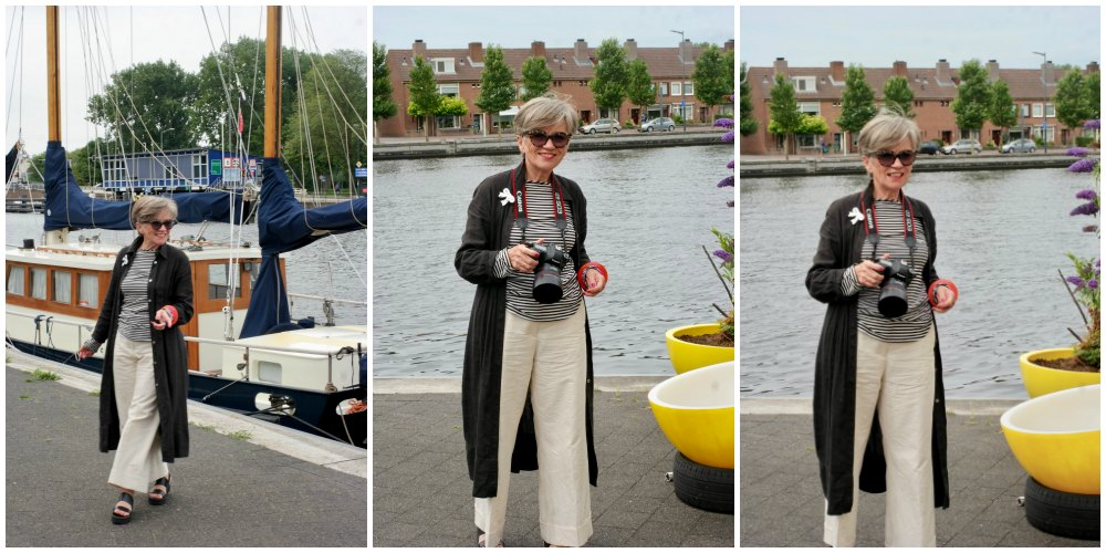 Woman poses at river bank in Haarlem |curlytraveller.com