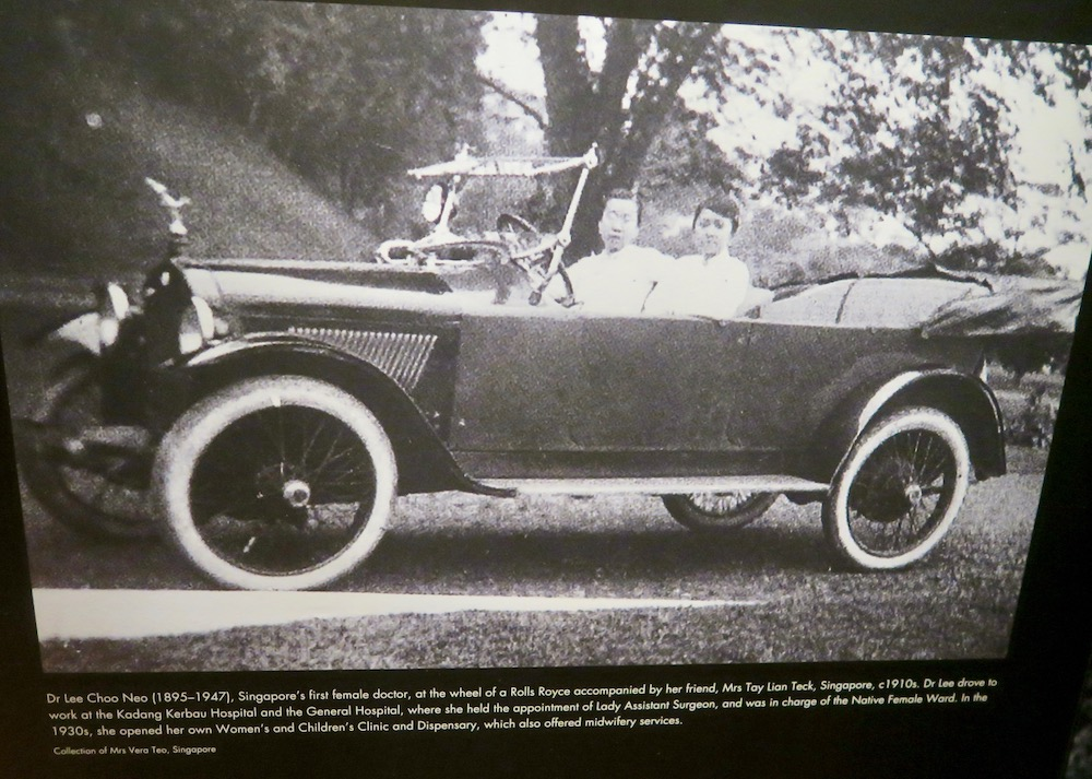 Two women driving an old-timer car in Singapore |curlytraveller.com