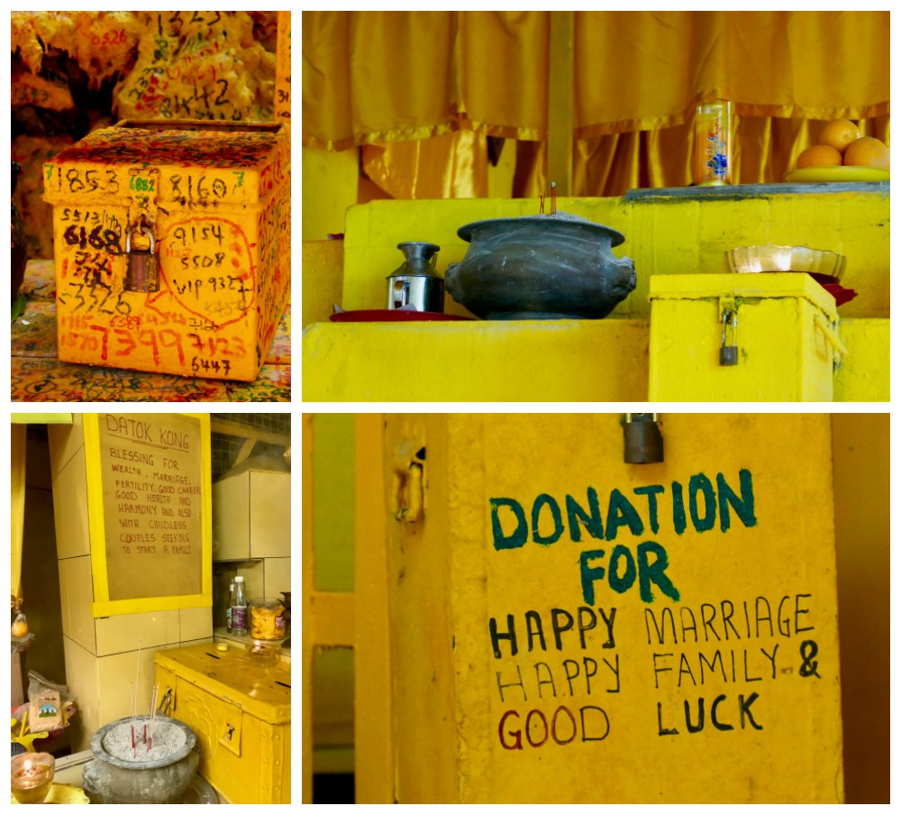 Donation boxes at temple at Kusu Island |curlytraveller.com