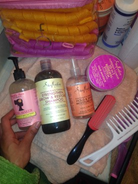 Price Breakdown: Camille Rose Naturals Curl Maker ($22, Target), Shea Moisture Superfruit Complex 10-In-1 Renewal System Hair Masque ($13, Target or Walgreens), Shea Moisture Jamacian Black Castor Oil Strenghten, Grow & Restore Shampoo ($11 Target or Walgreens), Shea Moisture Coconut & Hibiscus Oil Hold and Shine Moisture Mist, Coconut oil, Denman Brush ($11 Sally Beauty), Wide Tooth comb