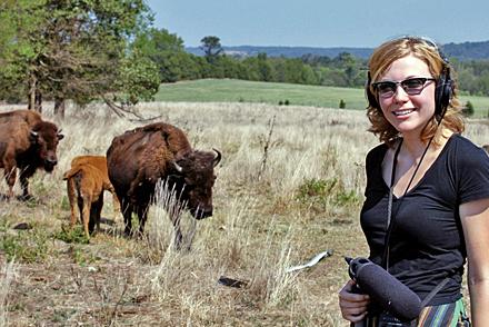 Harvest reporter Jessica Naudziunas stands in a field