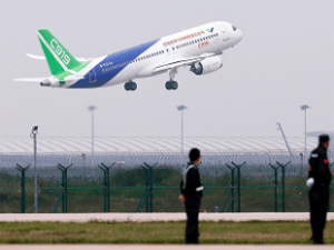 China's first homegrown jet takes off to challenge Boeing, Airbus