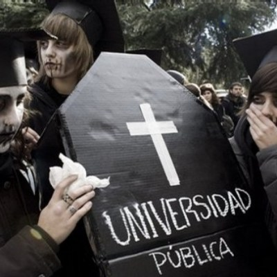 Students hold a coffin that reads 'public university' as they occupy the Office of the Dean of Complutense University, one of Spain's biggest, in Madrid on Thursday, Dec. 11, 2008. The students occupied the building peacefully and vow to stay indefinitely. They protest against the Bologna Process, an ongoing European education reform process that is transforming Spain's university system into shorter degrees, paid masters and financing from the private sector. Similar demonstration have taken place in other parts of Spain including Barcelona and Valencia.(AP Photo/Victor R. Caivano)