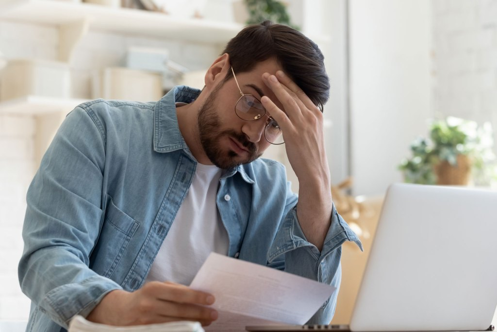 Man stressed in debt during the pandemic