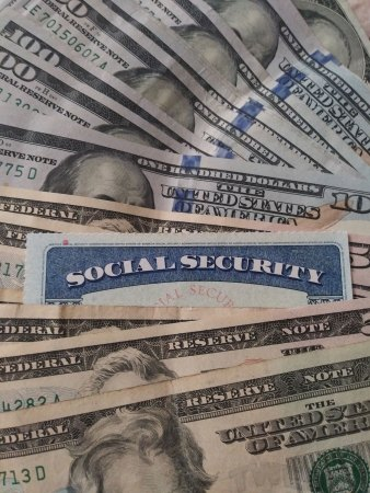 line of cash with a social security card