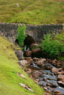 The Mountain Road bridge, straddling small waterfalls in the hills of the Brecon Beacons, National Park, Wales, United Kingdom.