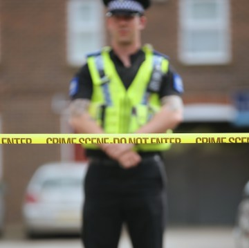 YORK, ENGLAND - APRIL 22: Police guard a home being searched at one of three locations in York as three men were arrested today in connection with the disapperance of missing chef Claudia Lawrence on April 22, 2015 in York, England. The new searches come in the wake of three arrests today in connection with the dissapearance of Claudia Lawrence who was last seen leaving work at the University of York's Goodricke College on March 18, 2009. (Photo by Christopher Furlong/Getty Images)