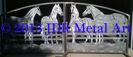 Horse themed driveway gates designed and plasma cut by JDR Metal Art with equine silhouettes for entrance to Florida ranch & stables.