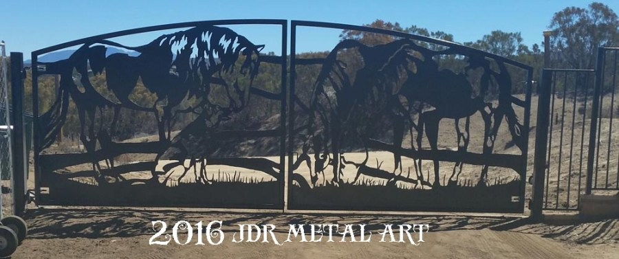 driveway gates in southern california featuring horses and dog silhouettes.