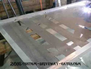Aluminum driveway gate panel with metal art design being welded in.