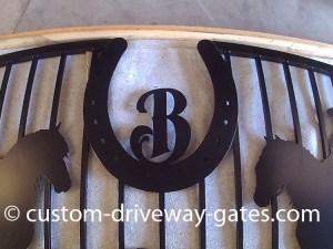 Aluminum driveway gate with horse shoe emblem plasma cut.