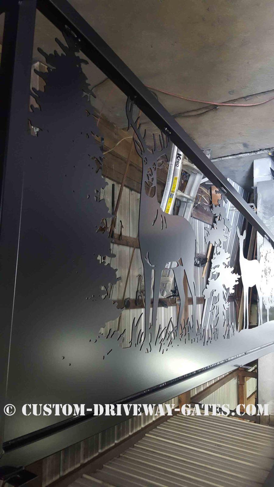 Black powder coated fence art panels.