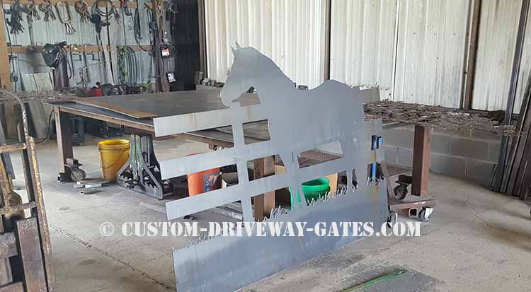 Driveway gate panel with horse design that has been CNC plasma cut from steel sheet.