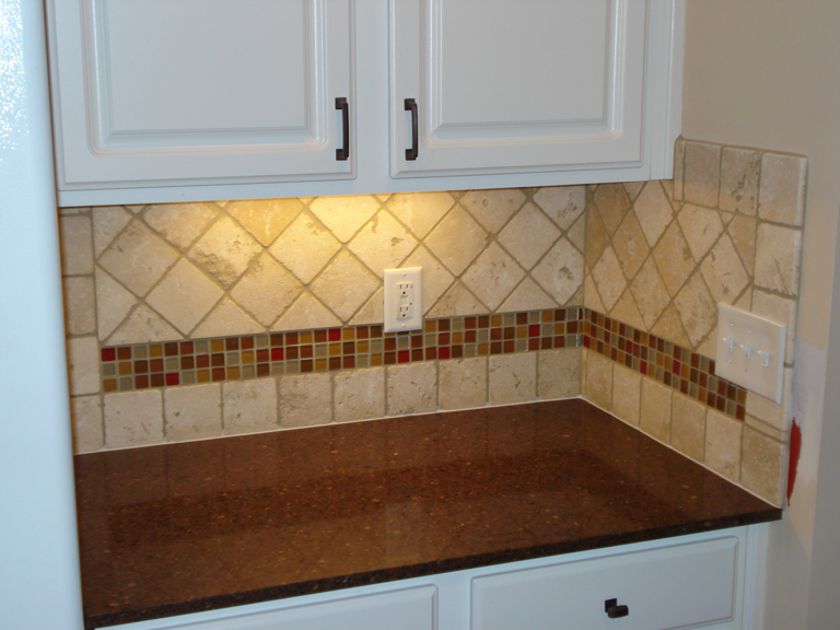 Tumbled Marble Backsplash With Multi-Colored Glass Accent