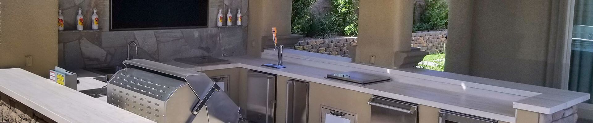 Custom Outdoor Kitchen Design and Contracting Services of Southern Nevada - Custom Outdoor Kitchen with Media Wall