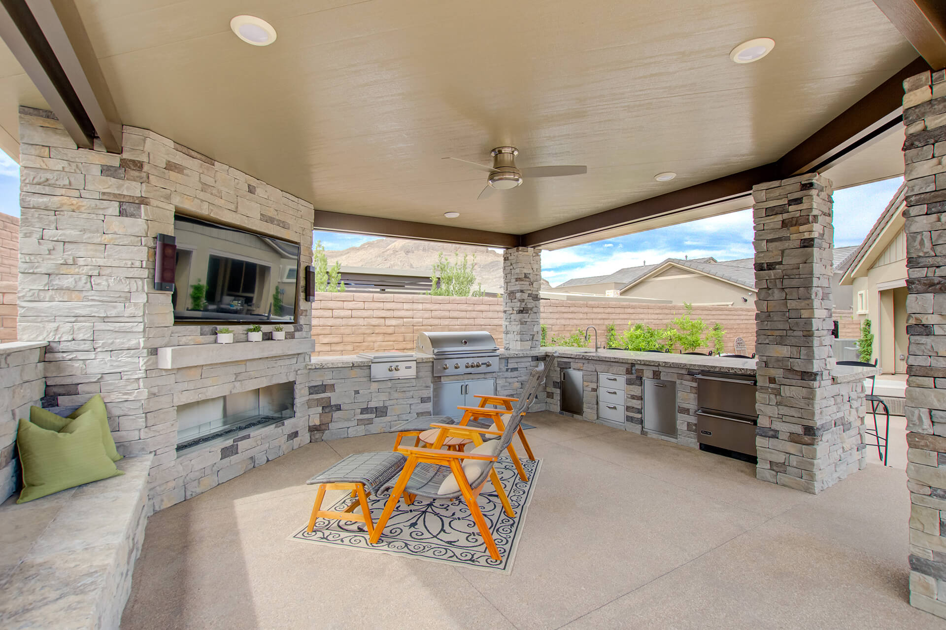 Media Wall with Recessed Outdoor TV and a Regency Outdoor Fireplace