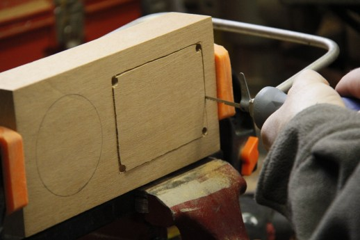 Using the coping saw to cut right on the line...