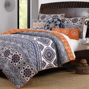 Exotic boho quilt in grey and orange spa colors
