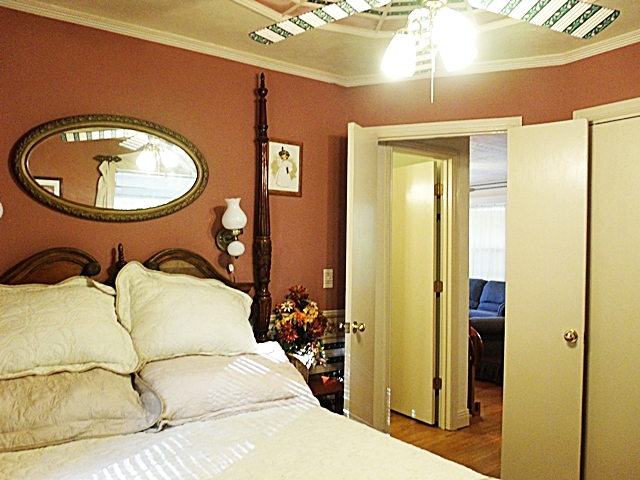 Queen size antique Rice-bed in the Beaver Lake Vacation Rental