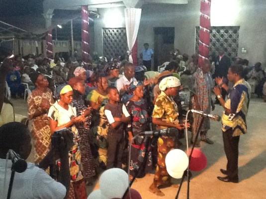 Apostle Kossou praying for the new converts at the convention