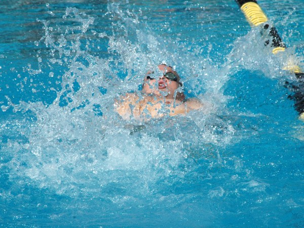 Senior Joey Tognolini swims at the WACC championship meet. Photo by Reyna Garcia/Copy Editor.