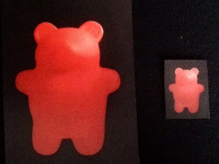 photos of one large red toy bear to the left of one small red toy bear
